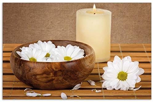 Wallario Herdabdeckplatte/Spritzschutz aus Glas, 1-teilig, 80x52cm, für Ceran- und Induktionsherde, Motiv Stillleben - Kerzen und Blumenblüten in Holzschale