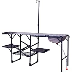 Portable folding outdoor cook station with counter and storage space for a camping stove or grill, cooking utensils, and cookware One-piece powder-coated steel frame unfolds to reveal an aluminum counter top, storage rack, fold-out side tables, colla...
