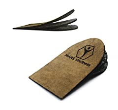"""Great For Leg Length Discrepancies, Heel spurs, Heel Pain, Sports Injuries, and Achilles tendonitis High quality rubber construction for Superb Heel Support 2 removable 1/8"""" thick layers for optimum Heel lift customization Durable and comfortable and..."""