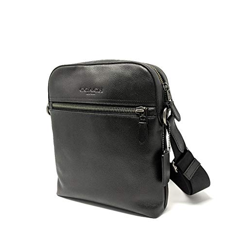Leather; Top zip closure Accented with gunmetal tone hardware; Strap is adjustable Exterior front has a zippered pocket; Rear has a slip pocket Interior lined with 3 slip pockets Measures approximately 9 L x 10 H x 2 D inches