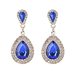 Drop earring material:created crystal,rhinestone,alloy;Size:3.5cmx1.6cm;Earring weight:6G(1 pec).Product color:Blue Fashion dangle drop bridal earrings for brides or bridesmaids with glistening pear-shaped drops. High quality cubic zirconium drop ear...