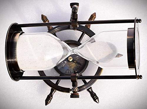 Clessidra nera in ottone pieno antico con base a bussola ruota