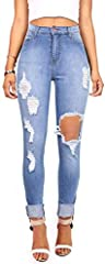 High waisted skinnys in a medium denim wash and distressing down the front with a hole on the left knee. Tradition 5 pocket jeans with a zip fly and button closure. Machine Wash Cold 73%Cotton 14% Rayon 11% Rayon 2% Spandex - Made in the USA