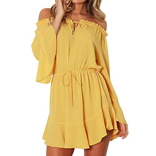 Vestido amarillo corto de fiesta.