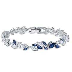 Stunning and elegant: This leaf-inspired bracelet combines the precision and quality of sparkling blue and white Swarovski crystals with a dainty rhodium plated setting, making it a refined accessory Vividly sparkling: Blue and white stones fill the ...
