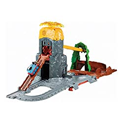 """Includes Die-Cast Thomas engine and removable shield piece Bridge Track that unlocks with special key Volcano """"eruption"""" feature with lights and sounds Zip-lining dragon with roaring sound Large playset easily folds up for storage and portability."""