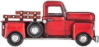 red truck with wreath