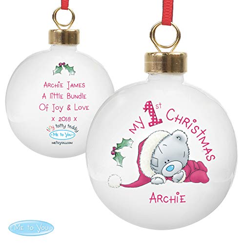 Personalise this 'Me To You' My 1st Christmas Bauble with a name up to 12 characters on the front and a message to the back over 4 lines of 20 characters per line. A lovely bauble which can be hung on the tree.