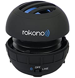 A small, round black and blue Rokono Bluetooth speaker like this one is an example of the many unique travel gift ideas for techie people.