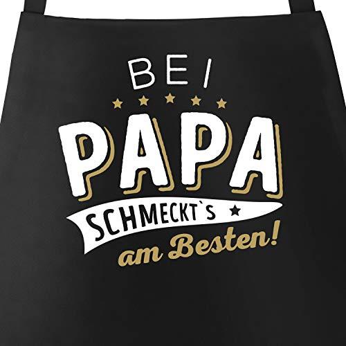 MoonWorks® Kochschürze Grill-Schürze für Männer und Frauen mit Spruch Bei Papa BZW Mama schmeckts am besten! Baumwoll-Schürze Küchenschürze Papa schwarz Unisize