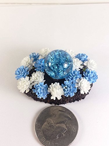 Miniature gazing ball and flowers. Fairy garden accessories, terrarium décor. Oval flower bed with cracked marble. Aqua blue.