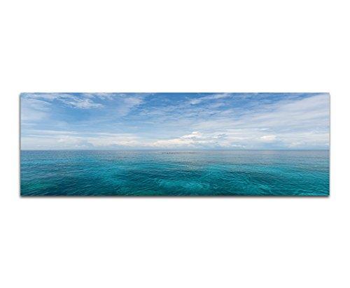 Paul Sinus Art Panoramabild auf Leinwand und Keilrahmen 150x50cm Meer Ozean Wolken Himmel