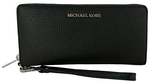 Large travel wallet wrapped in pebbled leather finished with polished silver tone hardware` Zip around style with iconic logo on the front Interior features (16) card slips, a clear ID slot, a zippered pocket and multiple full length bill compartment...
