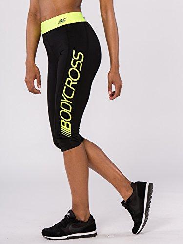 Bodycross 3/4-leggings dames Paula Running, trail, training met elastische riem neongeel en zak met ritssluiting op de rug ademend, licht en nauw op het lichaam - groot logo op de linkerpijp
