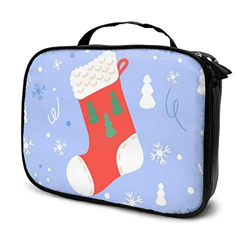 Sacs à cosmétiques pour les voyages des femmes, bas de Noël sur fond bleu. Étui à crayons avec symboles de vacances