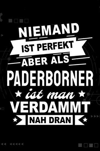 Niemand ist perfekt aber als Paderborner ist man verdammt nah dran: Notizbuch, 120 Seiten, DIN A5 (6x9 Zoll), Punktliniert, Softcover Matt, Lustiges Geschenk für Paderborner, Notizheft Geschenkidee