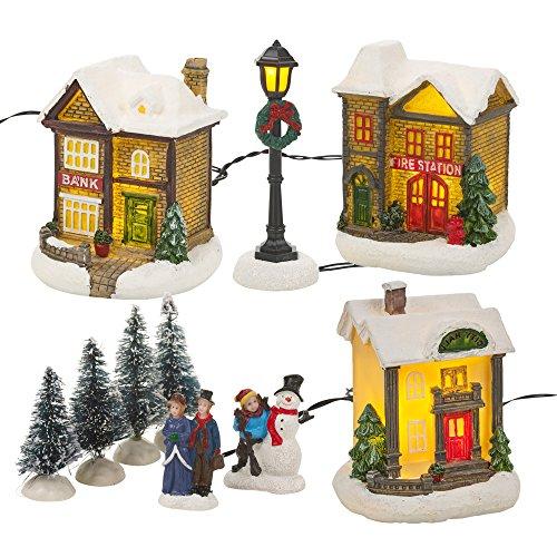 Pueblo en invierno de Navidad con luz led