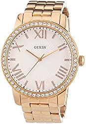 Elegant watch from the brand GUESS with a stone settled bezel Ip-rose stainless steel bracelet with fold over clasp/strap measurements: Length: 20 cm, width: 20 mm Case diameter: 42 mm, case thickness: 12 mm and the case colour: Ip-rose/dial colour: ...