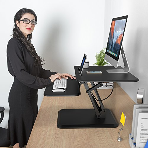 SLYPNOS Height Adjustable Standing Desk Converter Sit to Stand up Desk Riser, with Keyboard Mouse Deck and Cup Holder, 25 Inches Wide Ergonomic Workstation
