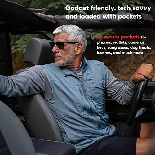 Grey haired man reversing a car wearing a lightweight vest.