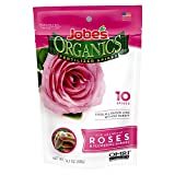 A bright pink plastic bag of Jobes' Organic Fertilizer Spikes Roses.