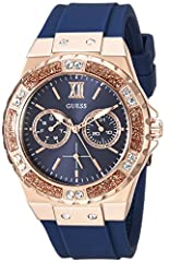 ICONIC BLUE MULTI-FUNCTION DIAL Features: Day + Date Functions 38.5 MM CASE SIZE with DURABLE MINERAL CRYSTAL that protect watch from scratches POLISHED ROSE GOLD-TONE CRYSTAL CASE COMFORTABLE BLUE STAIN RESISTANT SILICONE STRAP WITH ROSE GOLD-TONE B...