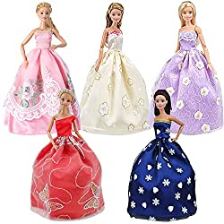 A variety of dolls in fancy dresses.