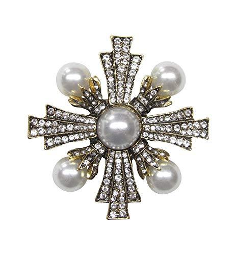 Broche de acero en forma de cruz estrellada con brillantes de cristal blanco y perlas nacaradas.