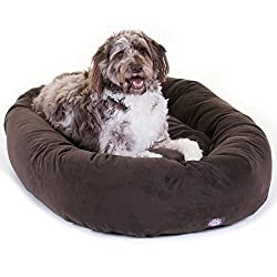 Brown shag dog laying on a brown suede bagel dog bed.