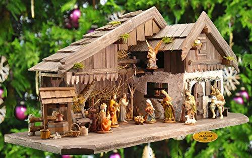 ÖLBAUM-Krippe KA70du-MF-ALP- XXL Holz - Weihnachtskrippe mit großer Bodenplatte, mit Holz-Brunnen MIT HOLZDACH + Premium-DEKOSET Alpenland, Massivholz Dunkelbraun - mit 12 x