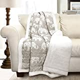 "Soft, 100% microfiber fabric reversible sherpa throw measures 60"" x 50"" and contains a cotton/poly blend filling. A perfect fuzzy elephant blanket for the living room, foot of the bed, nursery or as a gift. Decorative, white elephant design set again..."