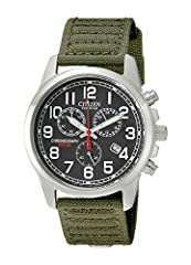 Military-inspired stainless steel watch with round dial, red contrasting second hand, and rugged green canvas band Japanese quartz movement with analog display. Operating temperature range is -10°C to +60°C/14°F to 140°F Charges in natural sunlight o...