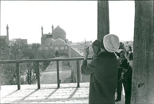 Vintage photo of Farah Pahlavi with her filmcamera during Baudouin of Belgiums visit to Iran