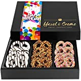 READY TO GIFT: Give the ultimate gift of giving with this beautiful eye popping pretzel gift box. Hazel and Creme chocolate covered pretzel have a delicious combination of flavors and textures. Each pretzel is generously dipped into dark chocolate to...