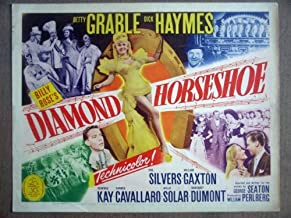 GZ04 Diamond Horseshoe BETTY GRABLE Title Lobby Card. This is a lobby card NOT a video or DVD. Lobby cards were displayed in movie theaters to advertise the film. Lobby cards measure 11 by 14 inches.
