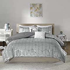 Product Features - Ultra soft brushed microfiber with metallic geometric silver printing. The reverse comes with brushed microfiber to keep you comfortable, cozy and snugly at night Fabrication - polyester brushed microfiber accented with geometric s...