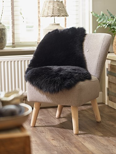 Yukon International Schaffell Teppich, ca. 90cm x 55cm, schwarz, echte Schafwolle, ökologischer Herstellung, Bettvorleger, Wohnaccessoire