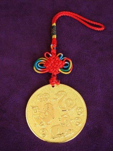 Horóscopo chino aliado amuleto para buey, serpiente y gallo