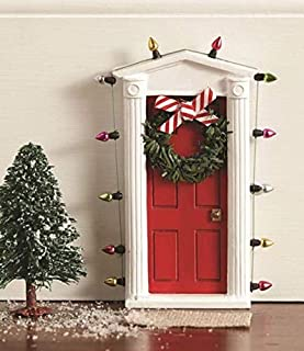 """Standing miniature dimensional door surrounded with """"lights"""" and tiny faux wreath with bow allows special entry for fairies and elves"""