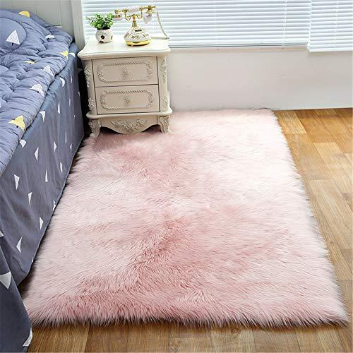 XDKS Alfombra de piel sintética suave y esponjosa, redonda, estilo piel de oveja sintética, alfombra de piel de cordero, alfombra de imitación de piel de cordero (50 x 80 cm), color rosa claro