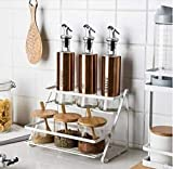 Space Saver. 2-Tier Free Standing Countertop Multi-Purpose Rack has wider taller shelves to ensure most spices, jars, cans, canisters, and condiments remain easily accessible when cooking or baking. Material: Steel. Color: White.