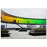 Denmark Aros Aarhus Kunstmuseum Jigsaw Puzzle 1000 Piece Wooden. Material: wooden. Number of pieces: 1000 pieces. Finished product size: 75 * 50cm / 30 * 20 inches. Each puzzle piece has letters on the back for easy classification. This is a great gi...