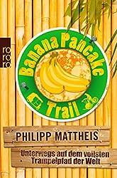 Buch Banana Pancake Trail von Philipp Mattheis, im Hintergrund ist Bambus, vorne ein Logo mit dem Titel und Bananen
