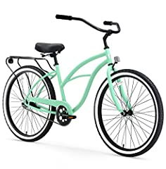 Classic, curvy women's beach cruiser bicycle with 17-inch durable steel frame; ideal for casual, comfortable riding around the neighborhood Upright riding style keeps your back and shoulders comfortable; dual-spring saddle and wide cruiser handlebar ...