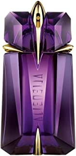 alien perfume gold bottle