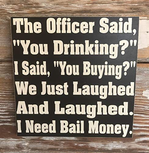 Letrero de Madera con Texto en inglés «The Agent Said You Drinking I Said You Buy We Just Laughed and Laughed I Need Bail»