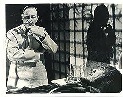 In Son of Frankenstein, Bohmer (Lionel Atwill) listens to Ygor (Bela Lugosi)