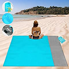 Excellent Quality:Beach blanket made from quick drying, breathable rip-stop 210T Polyester,and it can effectively prevent sand, water, and rips from damaging it.Just shake the blanket and it easily gets rid of all the sand once. Easy to Carry:Big siz...