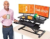Flexpro Hero 32 Inch Standing Desk | 2 Level Standing Desk Converter with Keyboard Shelf and Monitor Riser | Large Dual Level Sit to Stand Workspace | Easily Sit or Stand in Seconds! (Black / 32')