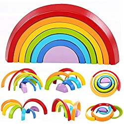 Best wooden toys for toddlers and preschoolers featured by top Seattle mommy blogger, Marcie in Mommyland: image of a wooden rainbow stacking game